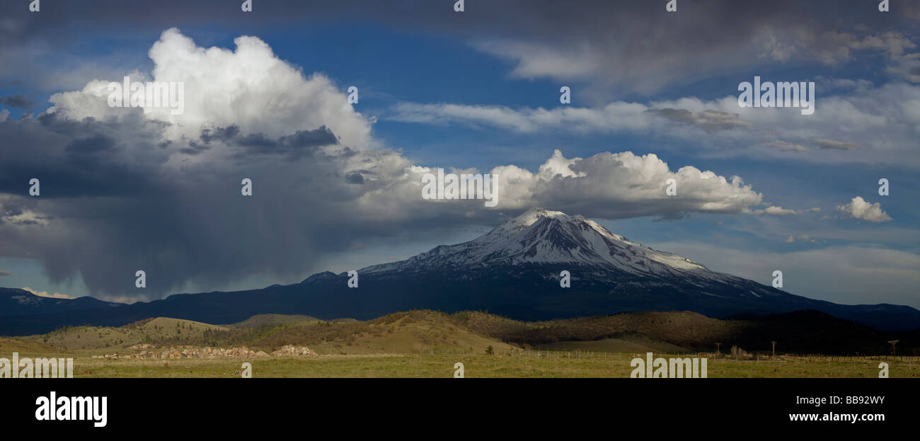 Siskiyou County, CA: View of Mount Shasta with scattered storm and rain clouds from Shasta Valley - Stock Image