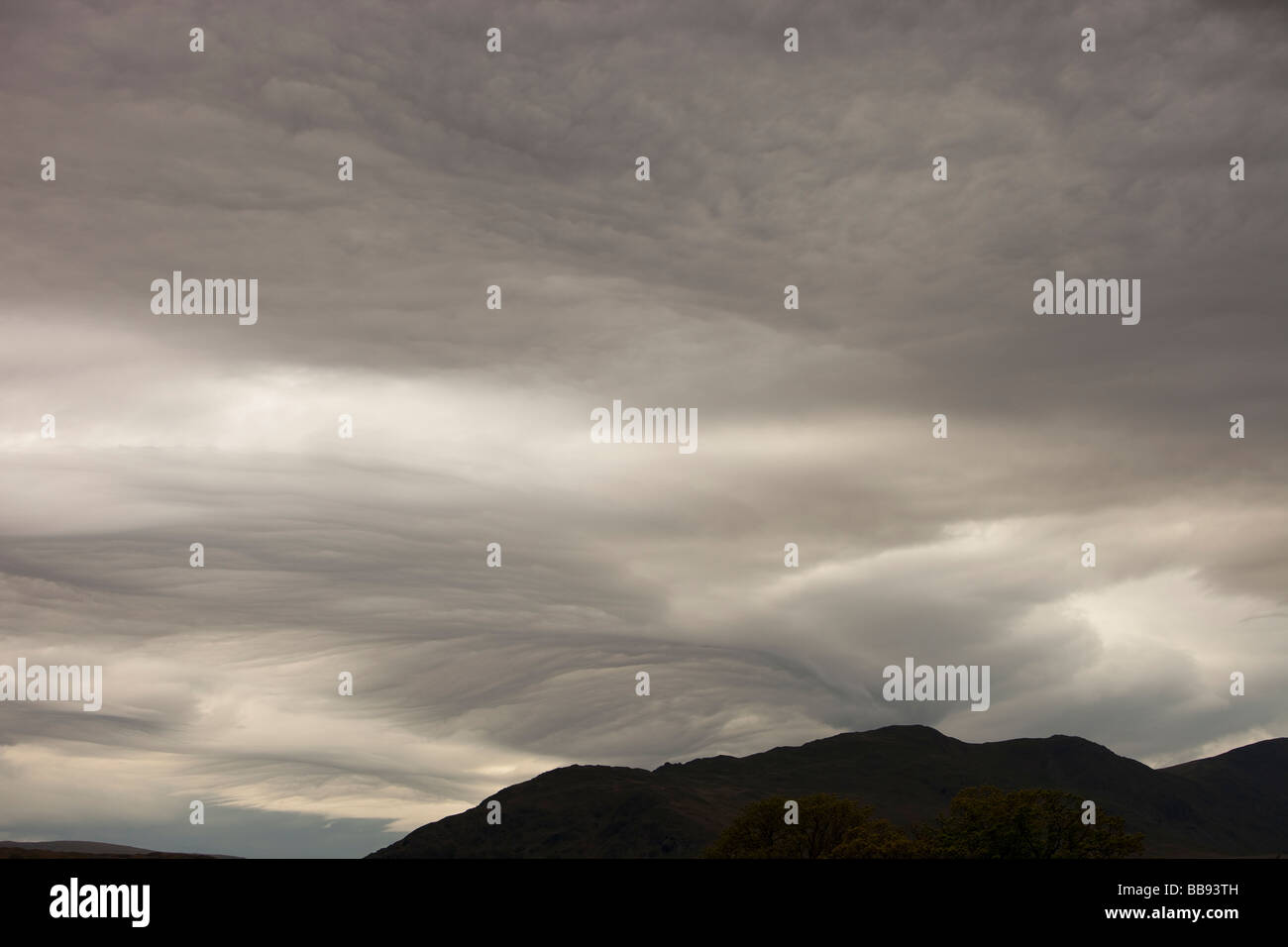 Patterns in cloud on an occluded front over the Lake District hills in Ambleside Cumbria UK - Stock Image