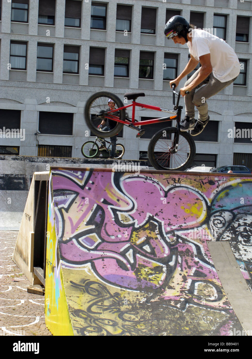 person doing bike stunts on ramp at event outdoors Stock Photo
