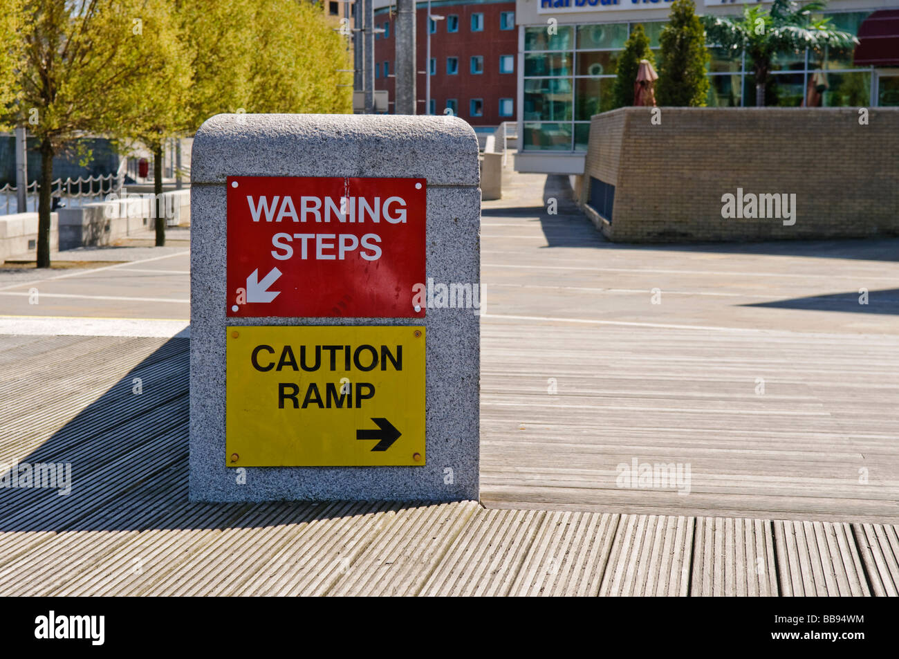 Two warning signs 'Warning steps' and 'Caution ramp' beside each other. Health and Safety gone mad. - Stock Image