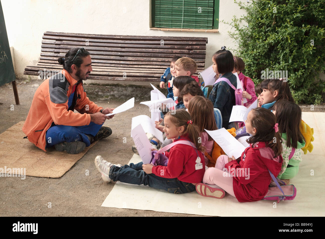 Primary school children enjoying an outdoor class in the grounds of Huerta de San Vicente Granada Granada Province - Stock Image