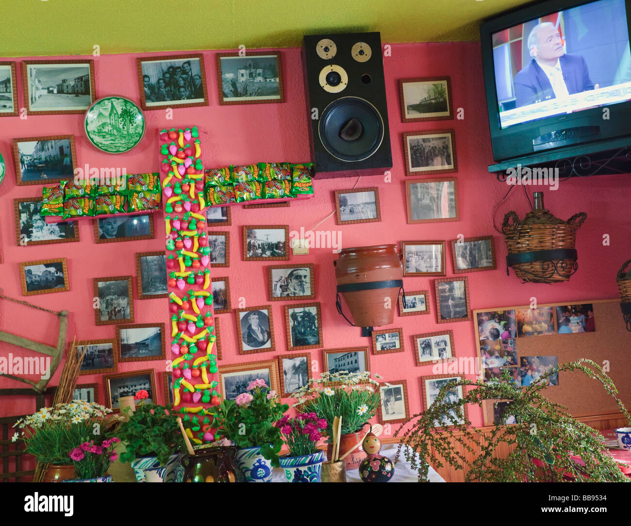 Cruz de Mayo or May Cross made from bags of potato chips and plastic fruit in Meson el Hijuelo Fuente Vaqueros Spain - Stock Image