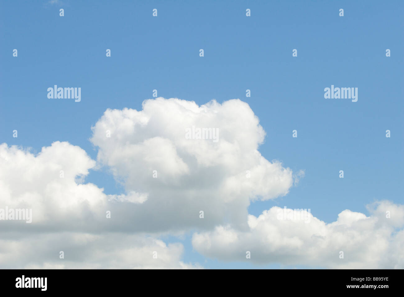 Fluffy clouds on a blue sky - Stock Image