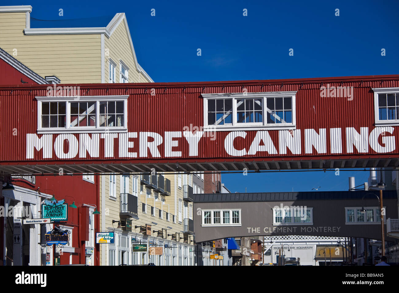 Monterey CA Historic buildings and signed skybridges spanning Cannery Row - Stock Image