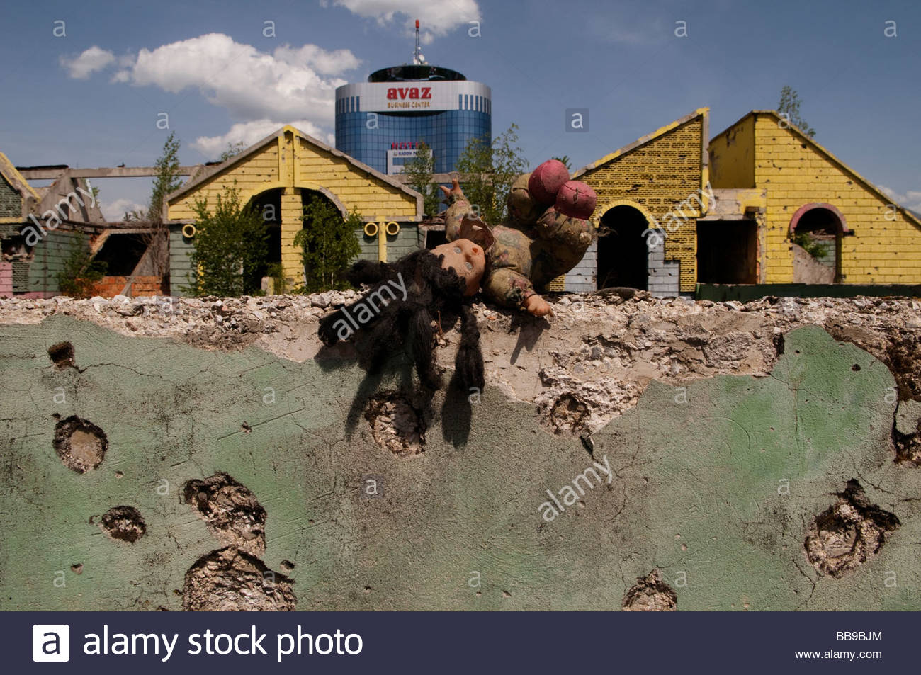 A doll over of wall which shows shrapnel damage from the 1992-95 war in downtown Sarajevo, Bosnia Herzegovina - Stock Image