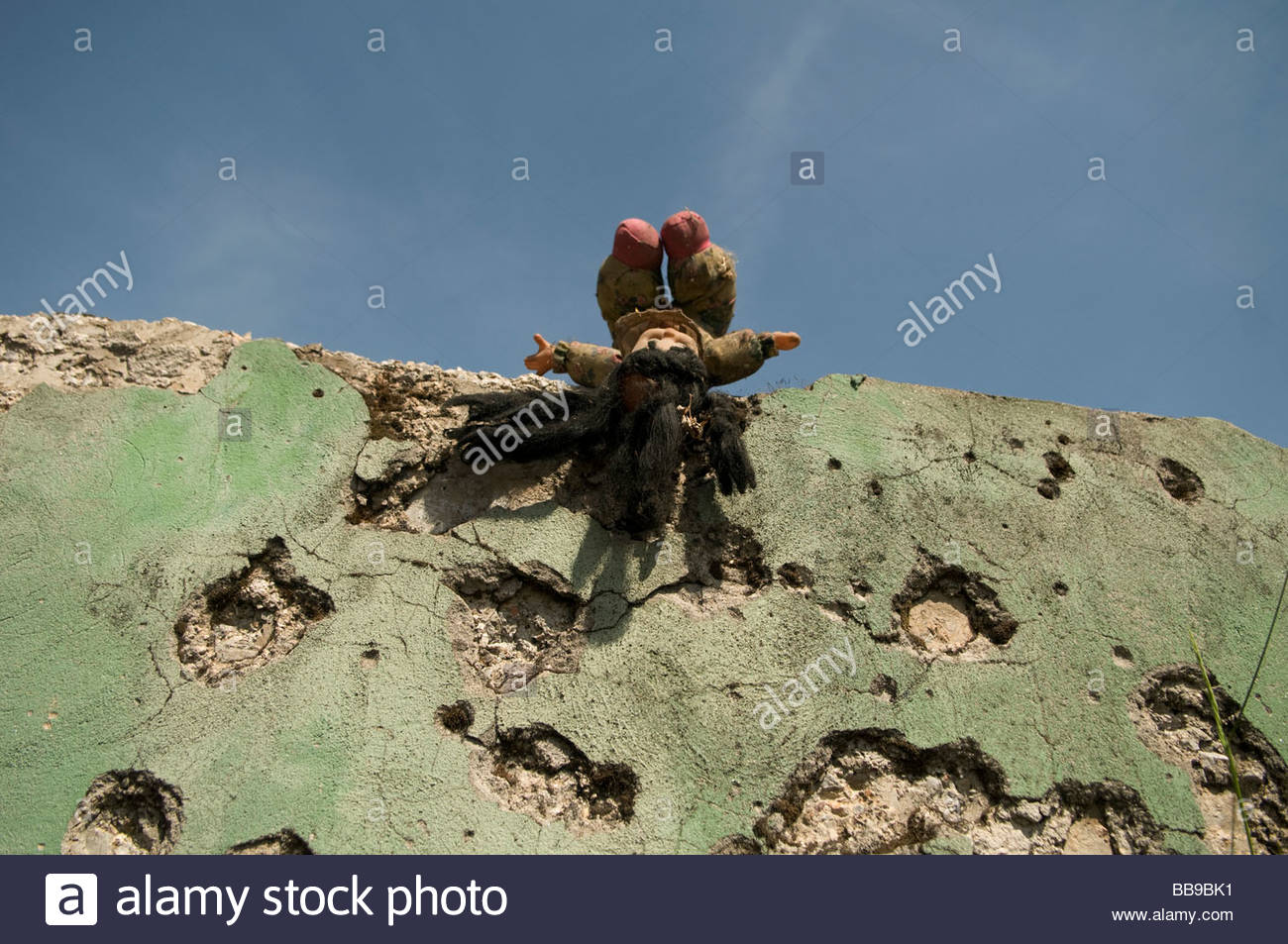 A doll over of wall which shows shrapnel damage from the 1992-95 war in Sarajevo capital of Bosnia Herzegovina - Stock Image