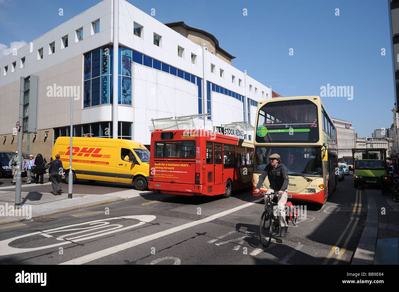 Heavy traffic with buses vans and a cyclist in Brighton city centre Stock Photo