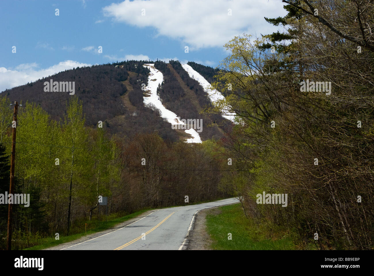 Road to Vermont's Jay Peak Resort in the spring, showing springtime ski trails. - Stock Image