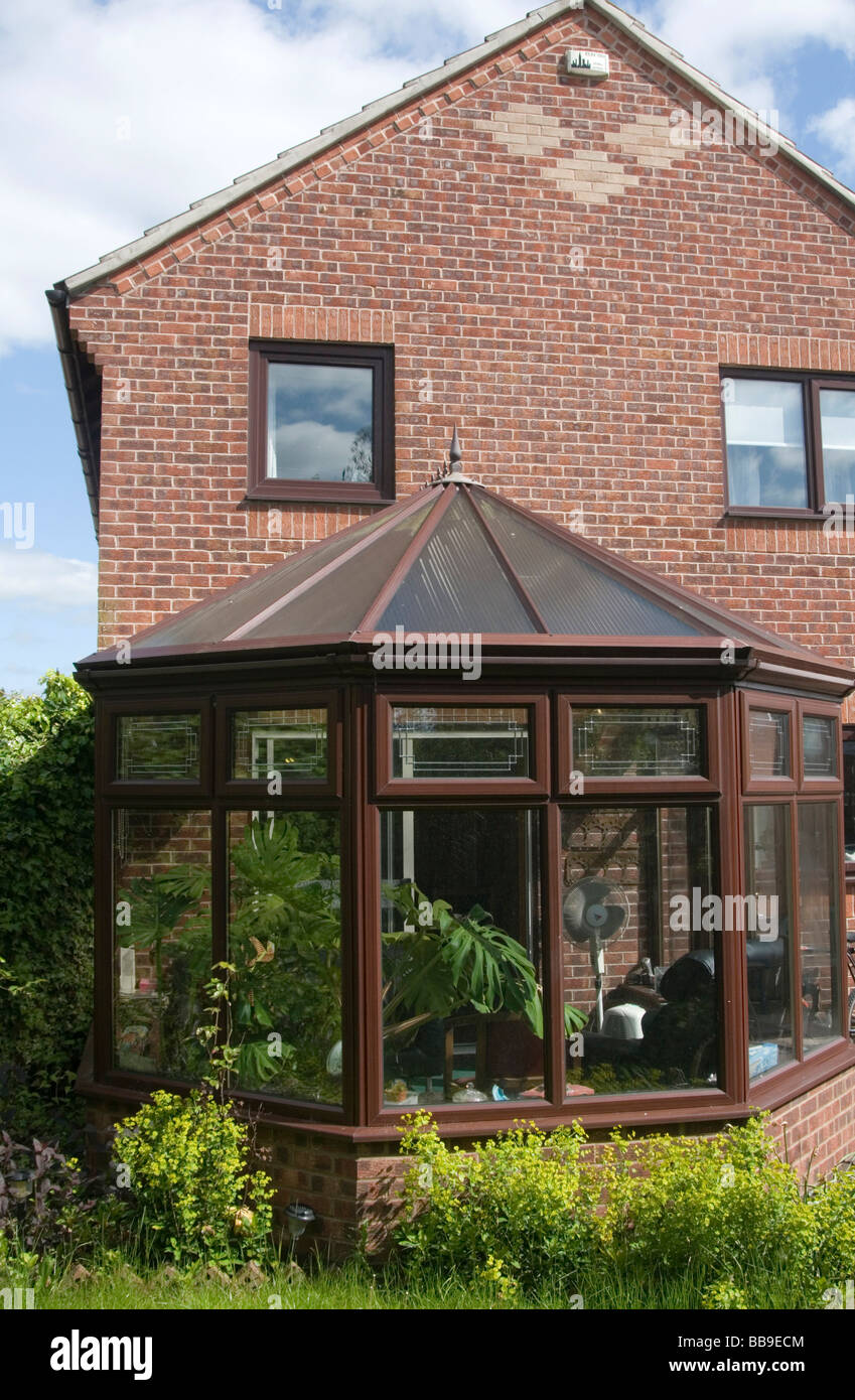 conservatory conservatories double glazed double glazing glass extension summer room house home uk upvc pvc plastic - Stock Image