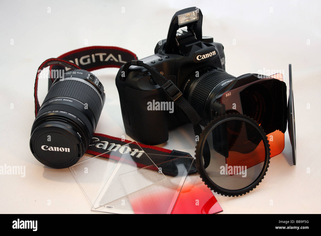 A close of photograph of a Canon 40D SLR Digital Professional Camera and  filters - Stock