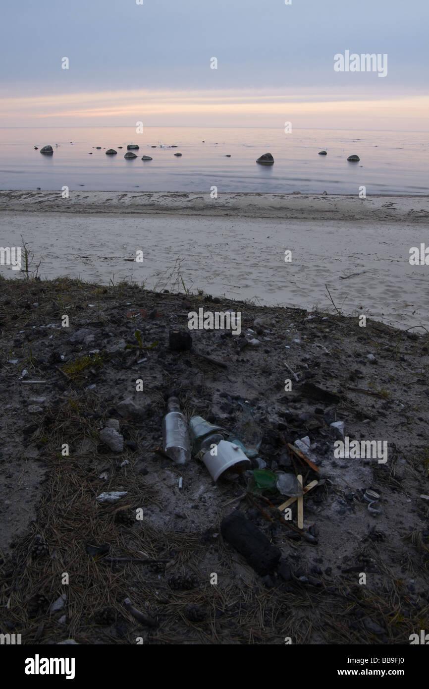 Trash on natural beach - Stock Image