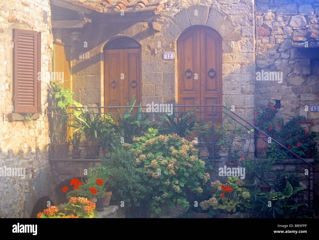 flowered patio of residential building region of tuskany italy - Stock Image