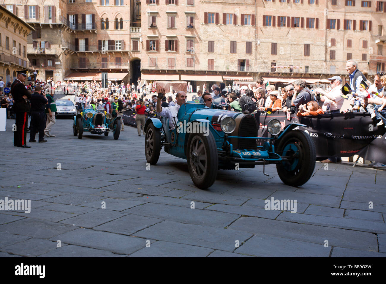 two vintage Bugatti cars arriving at Siena, Mille miglia rally 2009 - Stock Image