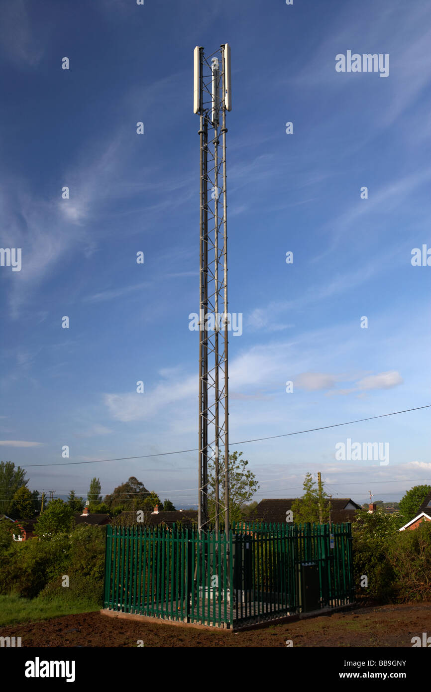 small mobile phone mast operated by vodafone in northern ireland - Stock Image