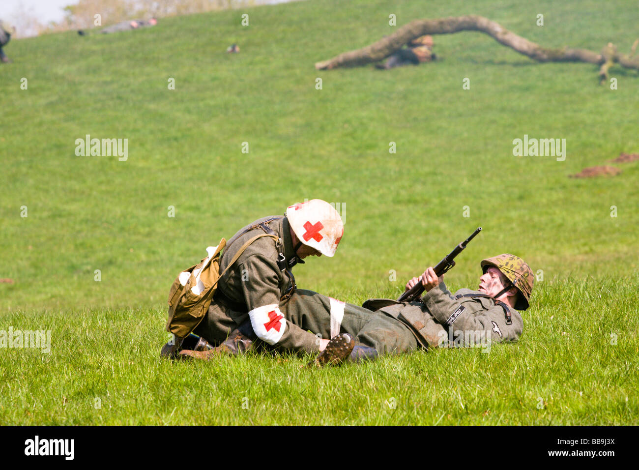 German army medic treats wounded soldier. GI's on Parade Moneymore, Londonderry, Northern Ireland - Stock Image