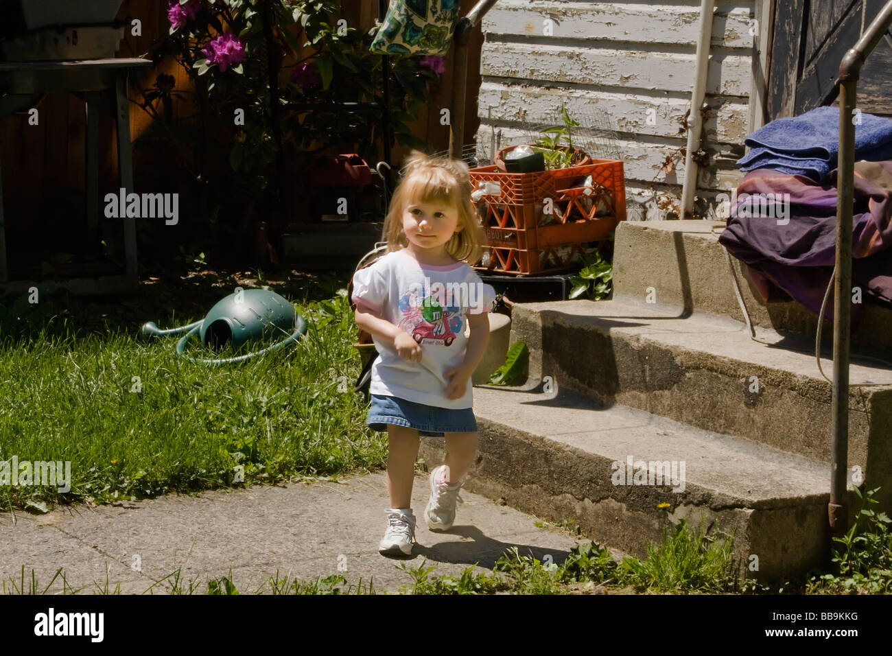 Little girl on the move - Stock Image