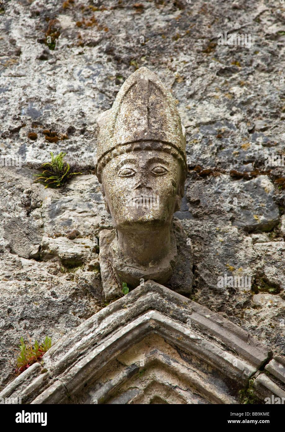 Carved head of bishop in Kilfenora Cathedral Burren County Clare Ireland Eire Irish Republic Europe EU - Stock Image