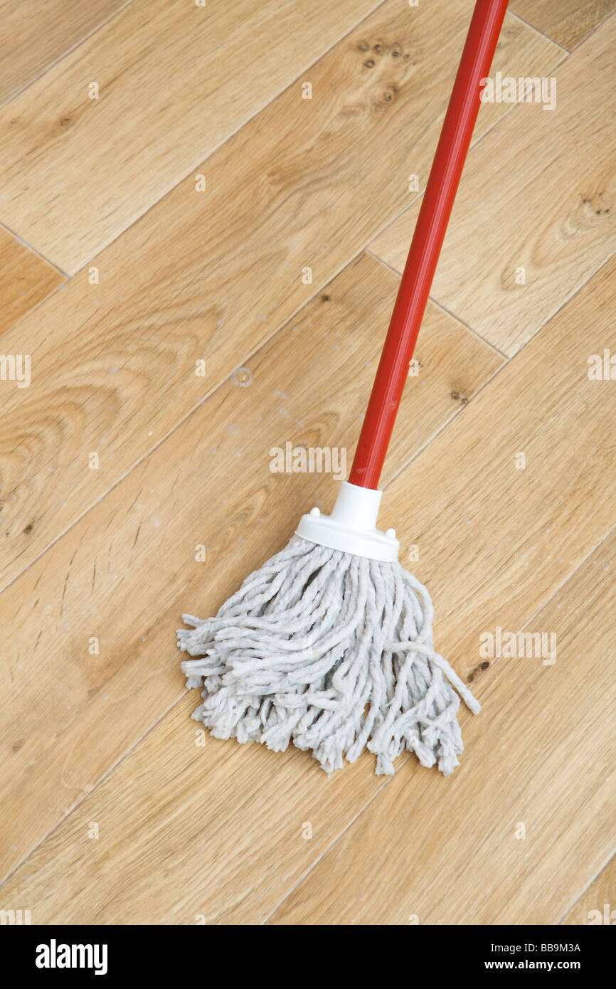 A red mop on floor - Stock Image