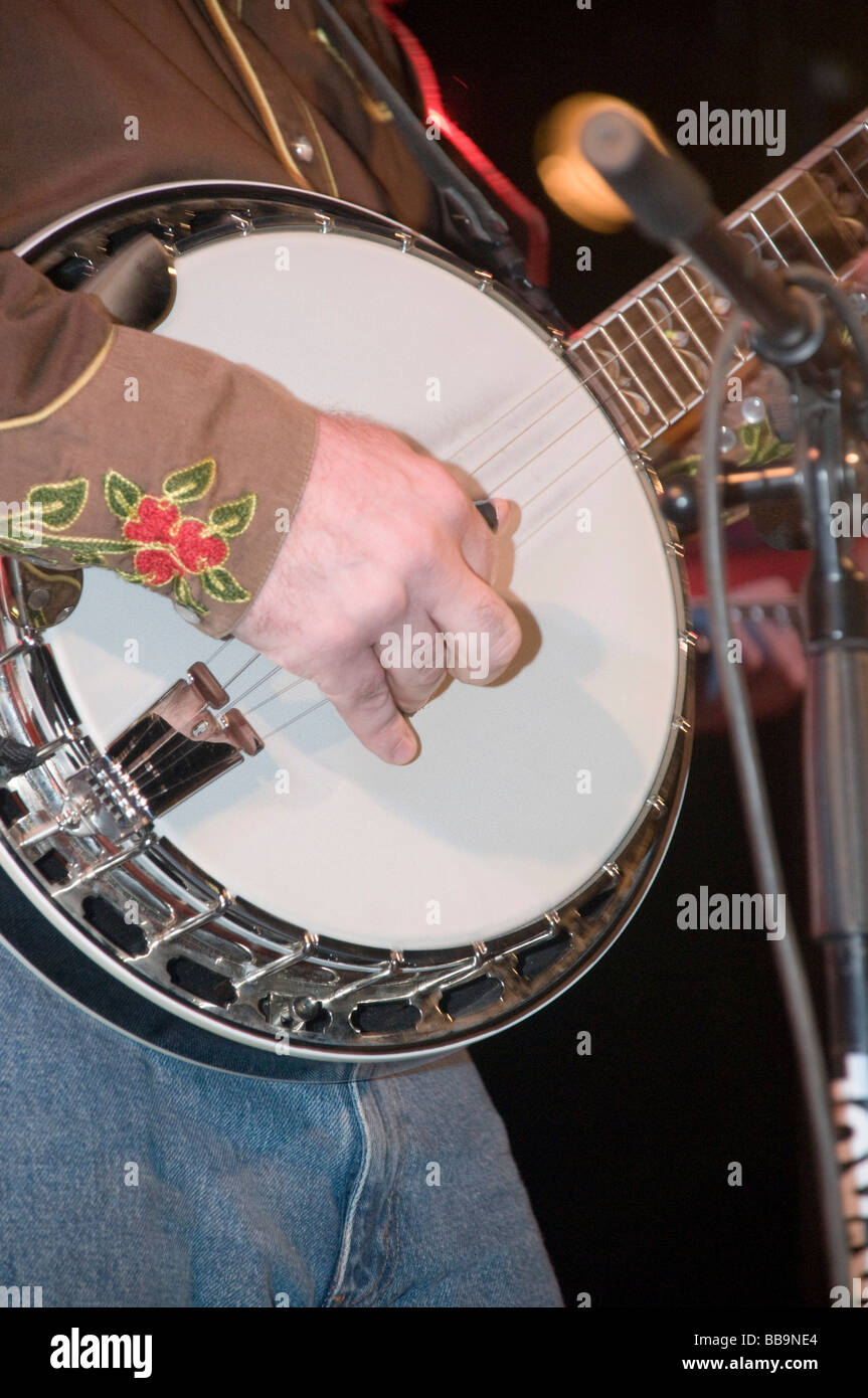 Close up of hands playing a banjo - Stock Image