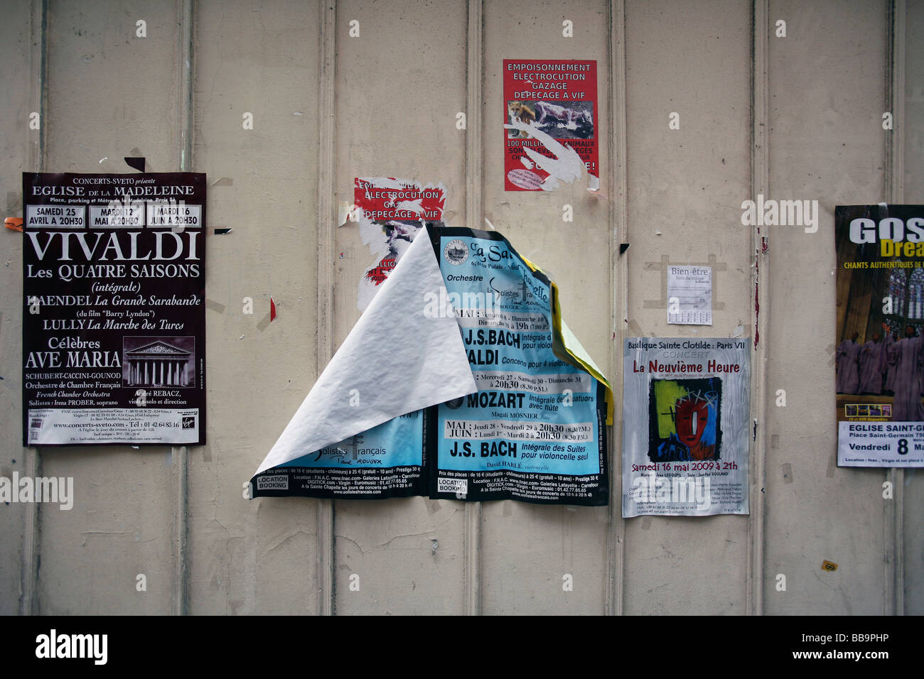 Paris wall advertising posters announcements - Stock Image