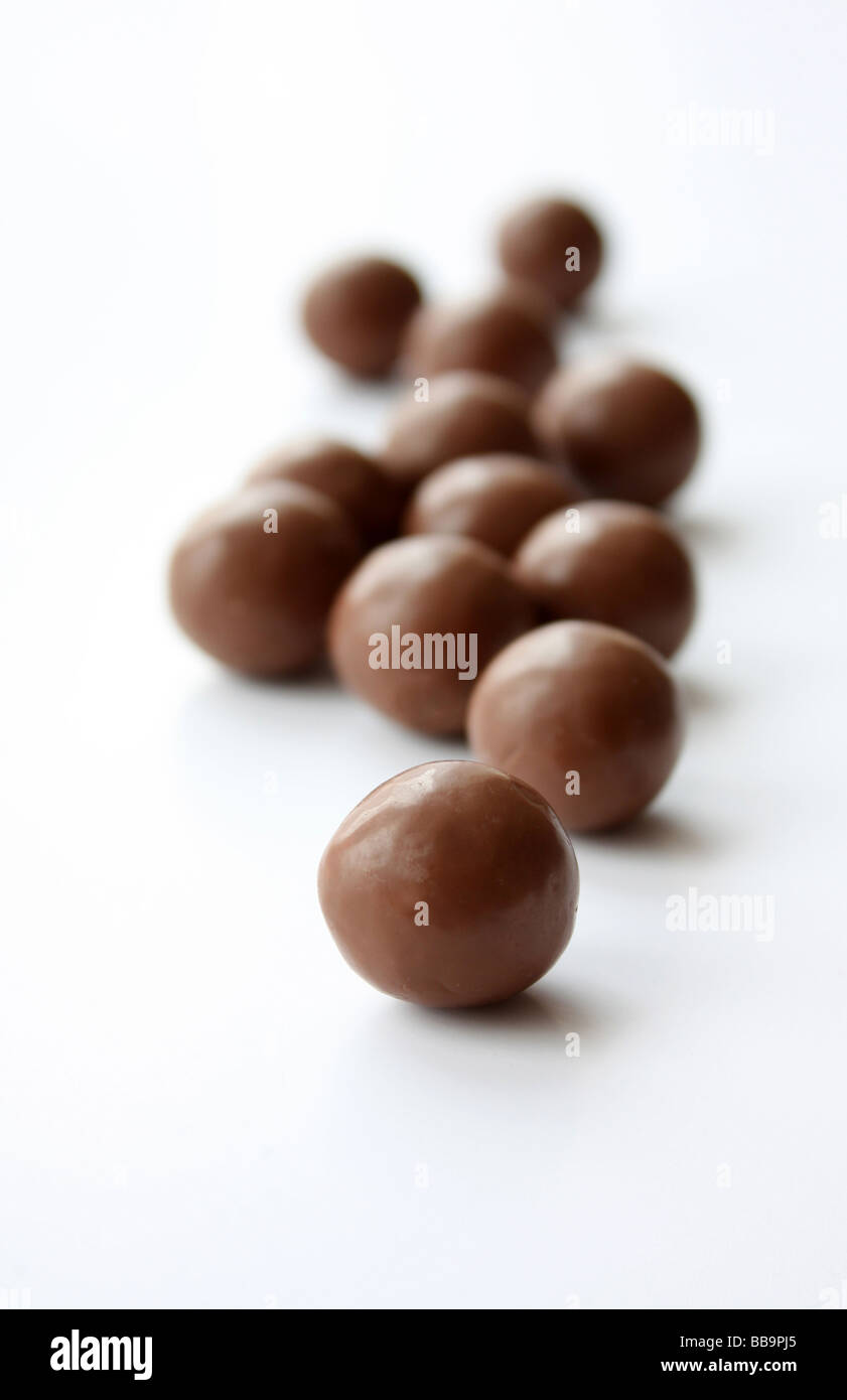 A handful of maltesers the round chocolates - Stock Image
