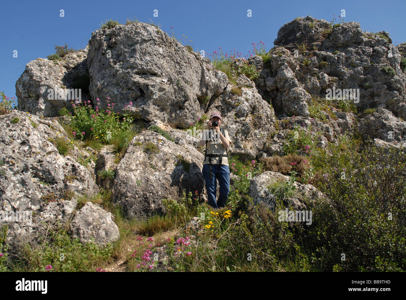 woman with camera, Sierra de La Forada, near Alcala de La Jovada, Marina Alta, Alicante Province, Comunidad Valenciana, - Stock Image