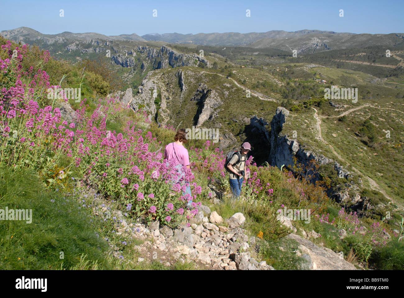 hikers on the Sierra de La Forada, near Alcala de La Jovada, Marina Alta, Alicante Province, Comunidad Valenciana, - Stock Image