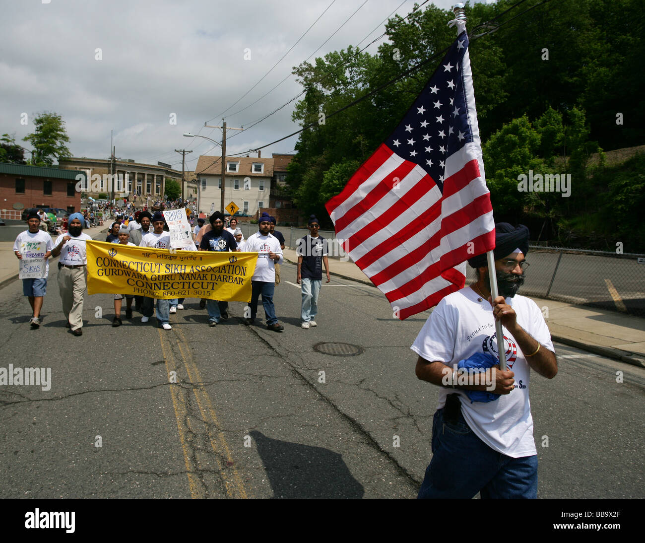 Sikhs march in a 4th of July parade in Shelton CT USA in honor of their veterans who fought in WWII for the USA - Stock Image