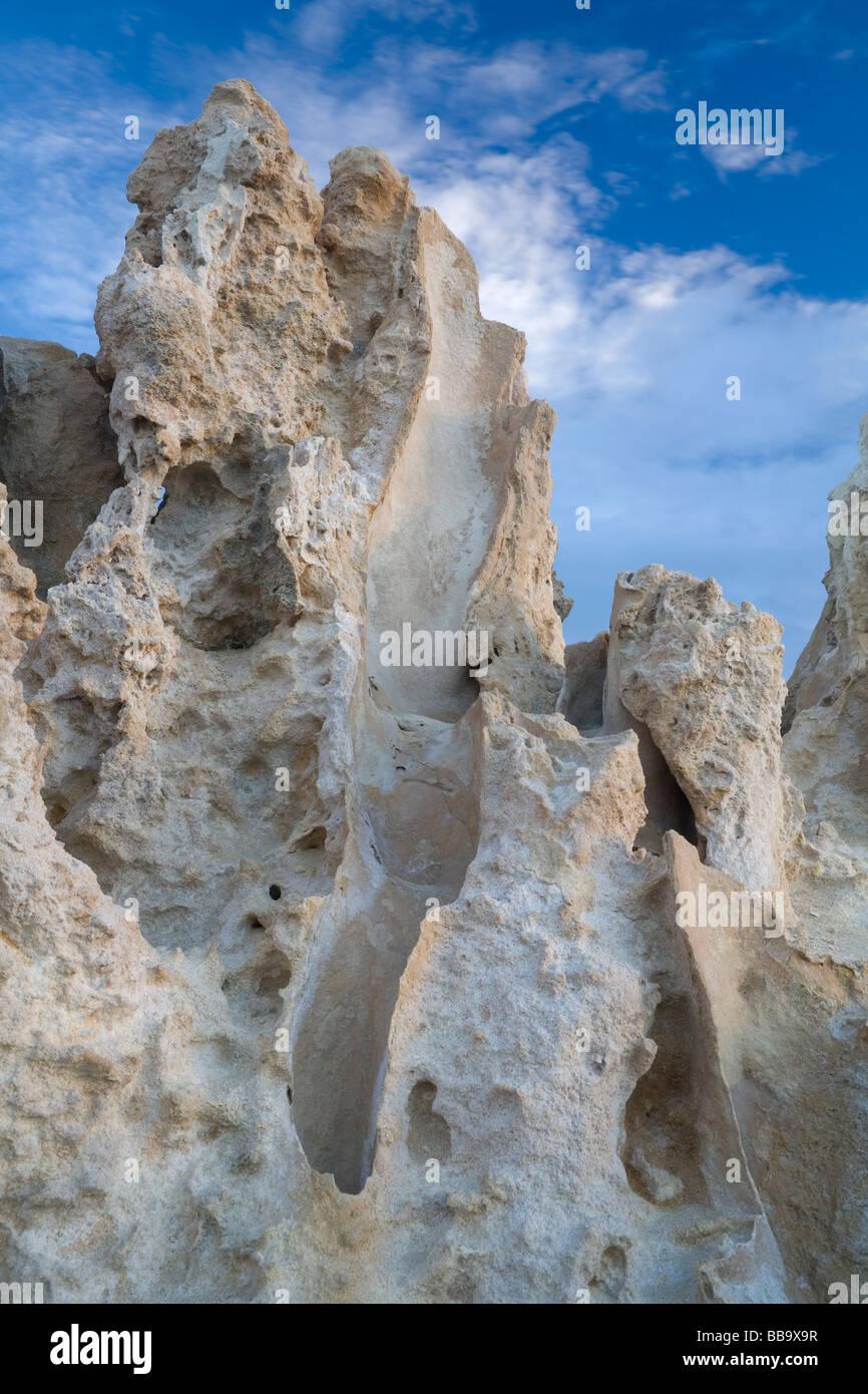 jagged and heavily weathered limestone rock - Stock Image