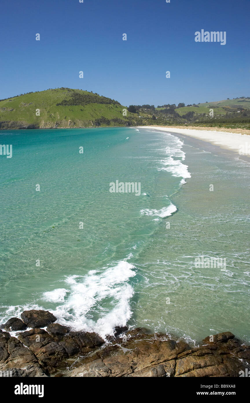 View across Purakanui Bay to Potato Point seen from Mapoutahi Historic Maori Pa Site north of Dunedin South Island Stock Photo