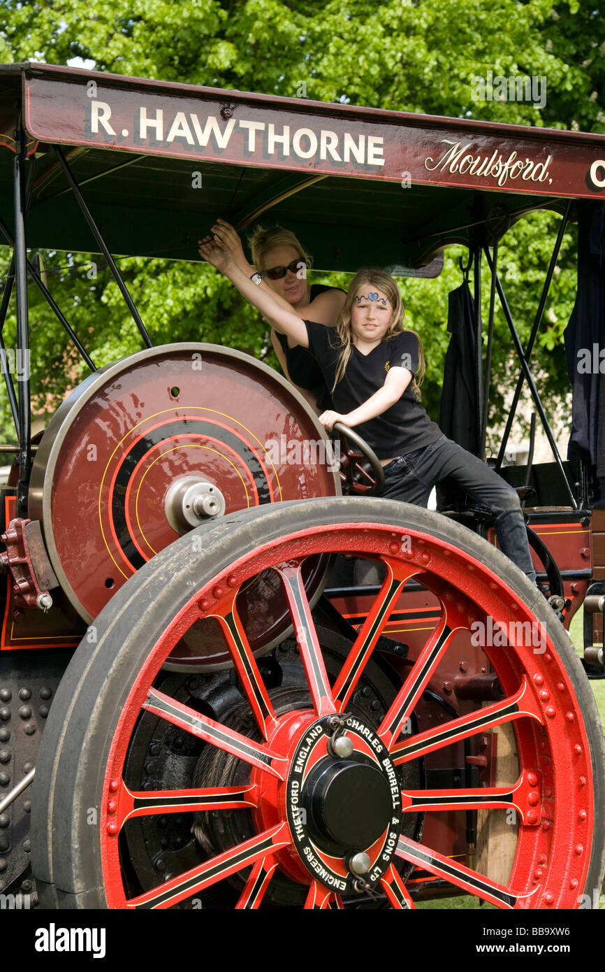A young girl in control of a traction engine, Wallingford , Oxfordshire, UK - Stock Image