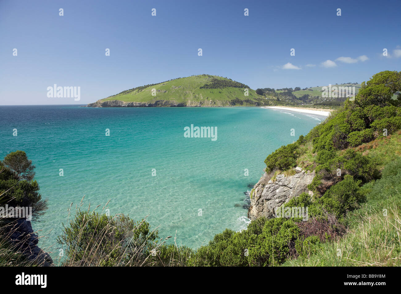View across Purakanui Bay to Potato Point seen from Mapoutahi Historic Maori Pa Site north of Dunedin South Island - Stock Image