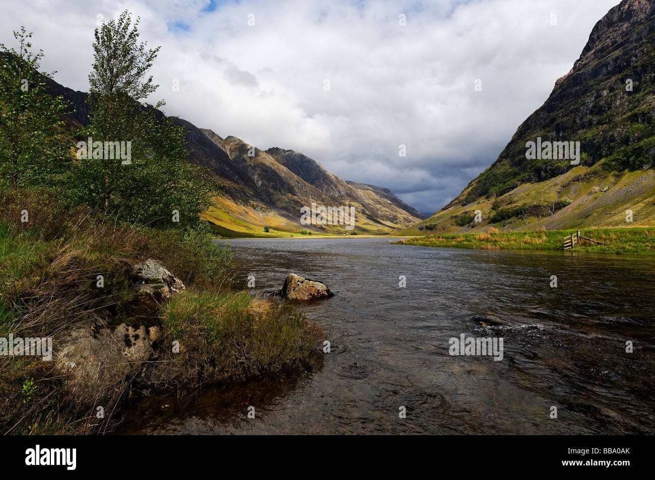 Loch Achtriochtan at the foot of Aonach Dubh in Glen Coe in the Scottish Highlands - Stock Image