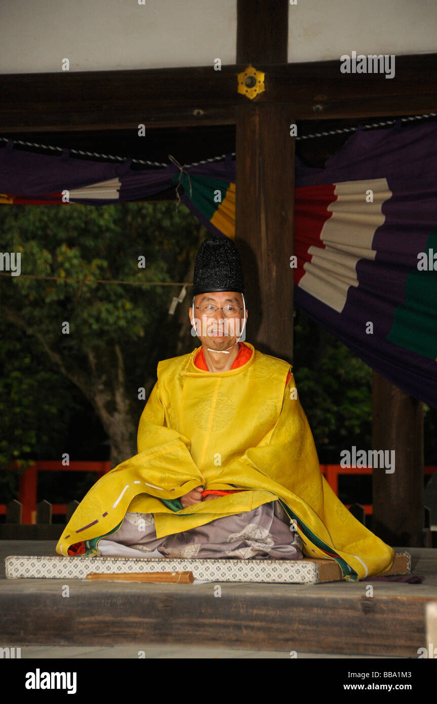 Priest watching the riders' contest from a shrine, equestrian festival at the Kamigamo Shinto Shrine, Kyoto, - Stock Image