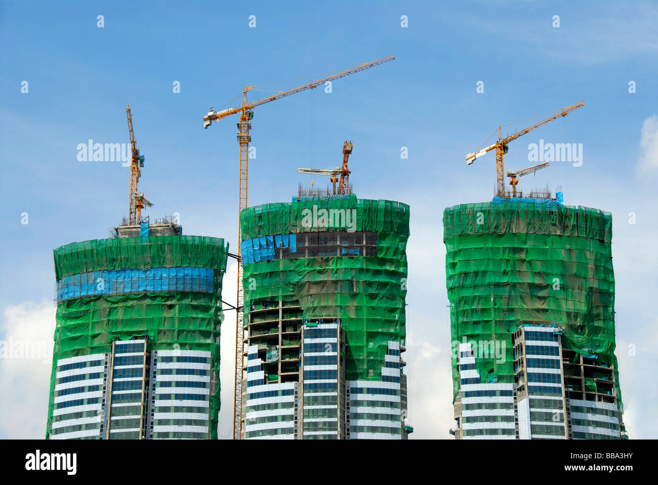 Skyscrapers, building site, cranes on three modern skyscrapers, Bangkok, Thailand, Southeast Asia - Stock Image