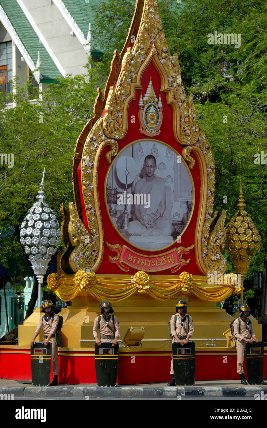 Demonstration, policemen with protective shields, standing guard in front of the statue of King Bhumipol, Bangkok, Stock Photo