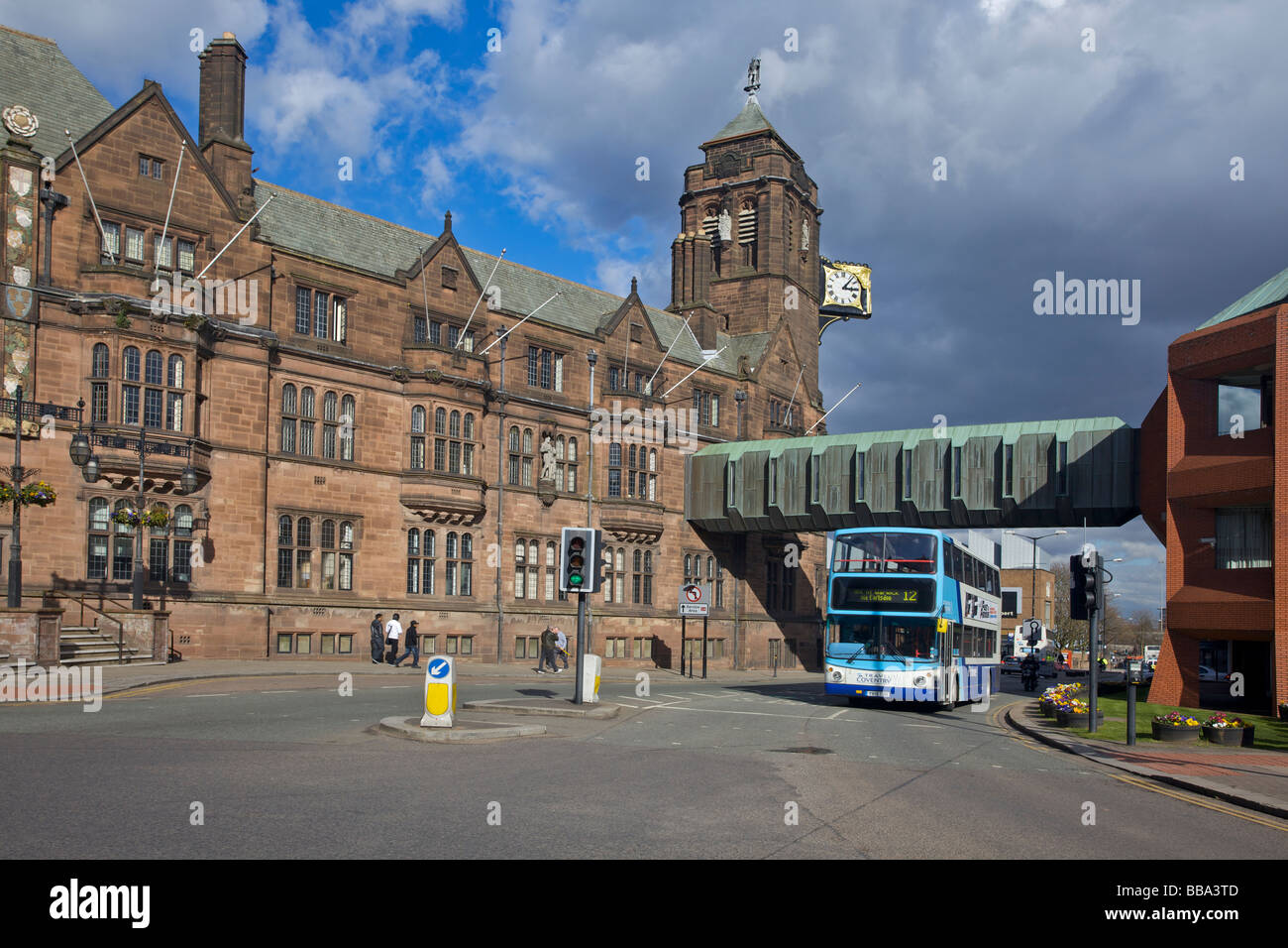 Double decker bus passing The Coventry City Council House in Coventry, West Midlands of England, United Kingdom Stock Photo