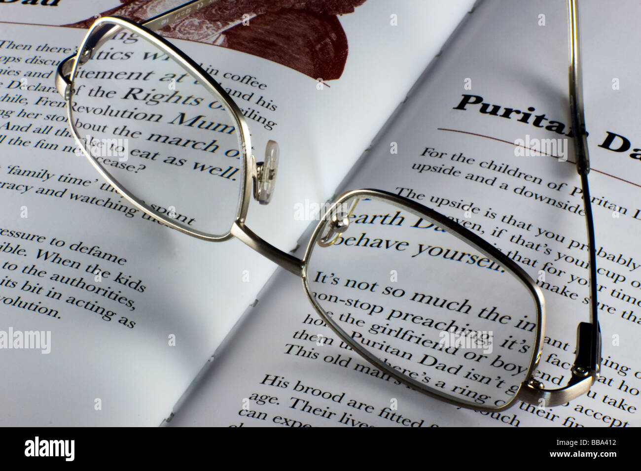 9442d3559d8 Close-up of a pair of spectacles resting on a book - Stock Image