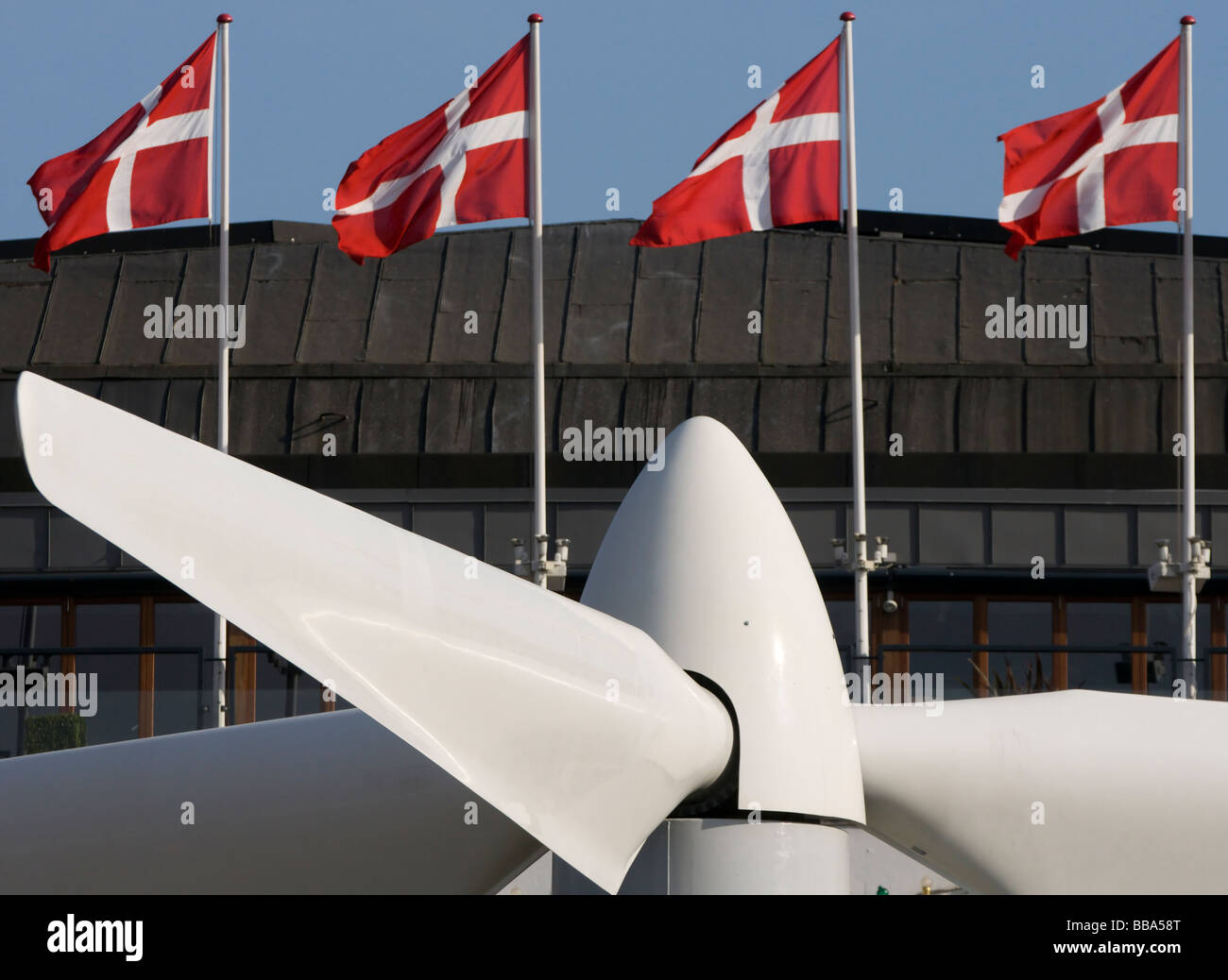 Tivoli Gardens in Copenhagen has placed a Vesta wind turbine in front of the Concert Hall this summer. - Stock Image