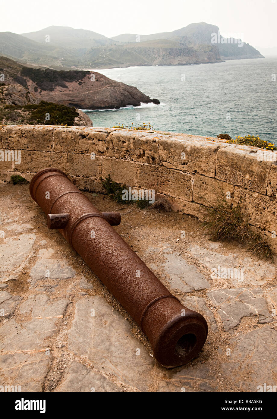 Canon in ruin of Torre d'Aubarca a watchtower on east coast of Mallorca Spain - Stock Image