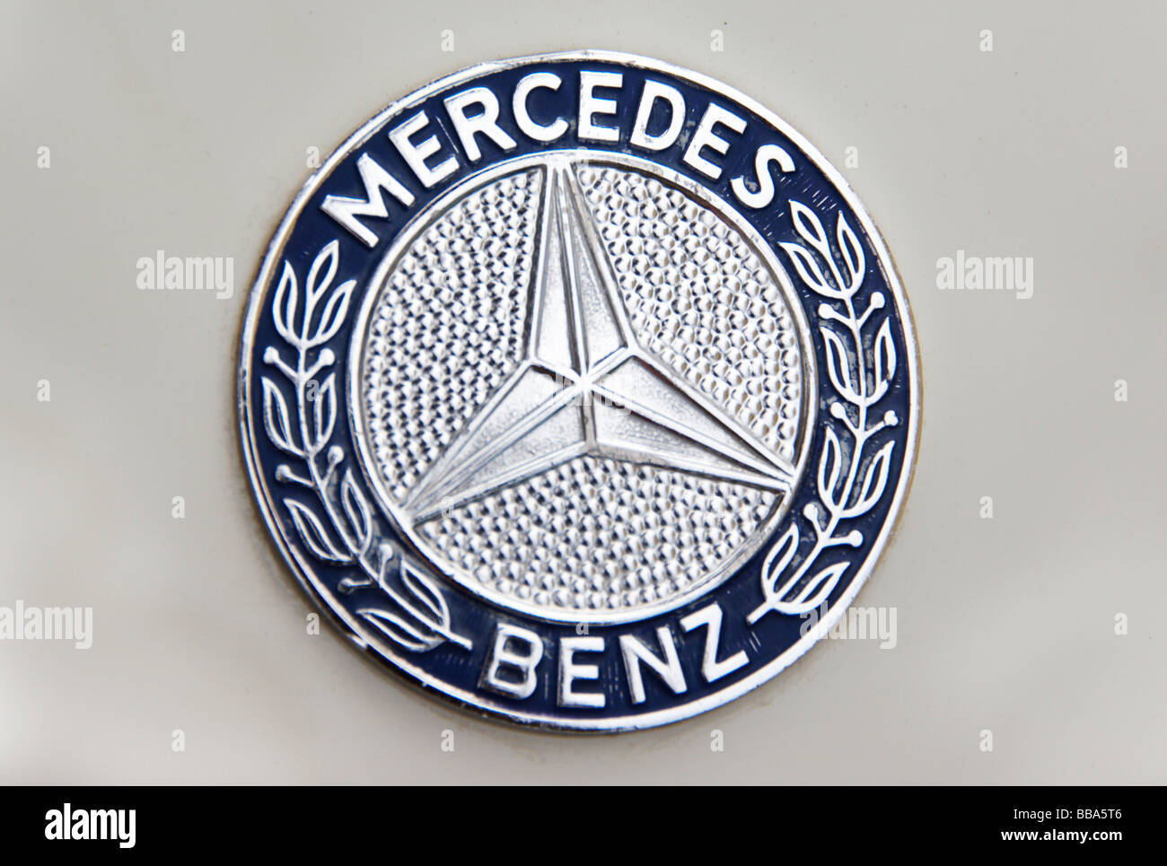 Old Mercedes Benz logo on classic car Stock Photo