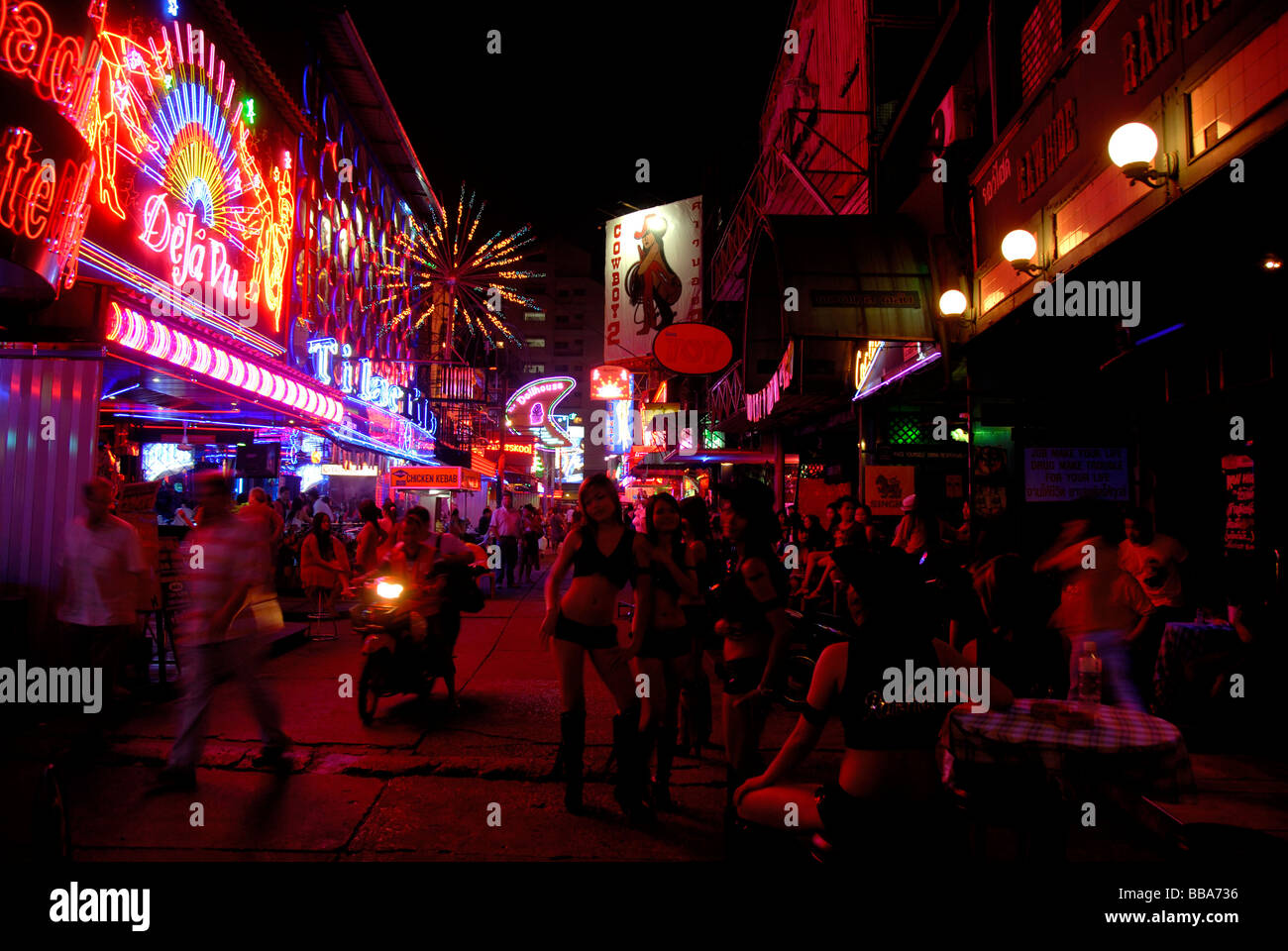 Nightlife, colorful neon signs, prostitutes in front of bars, red light district Soi Cowboy, Bangkok, Thailand, - Stock Image