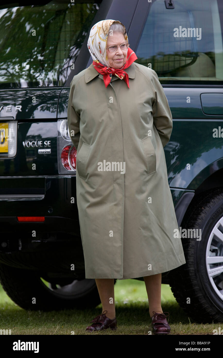 HM Queen Elizabeth II Wearing A Headscarf And Rain Coat At The Royal Windsor Horse Show
