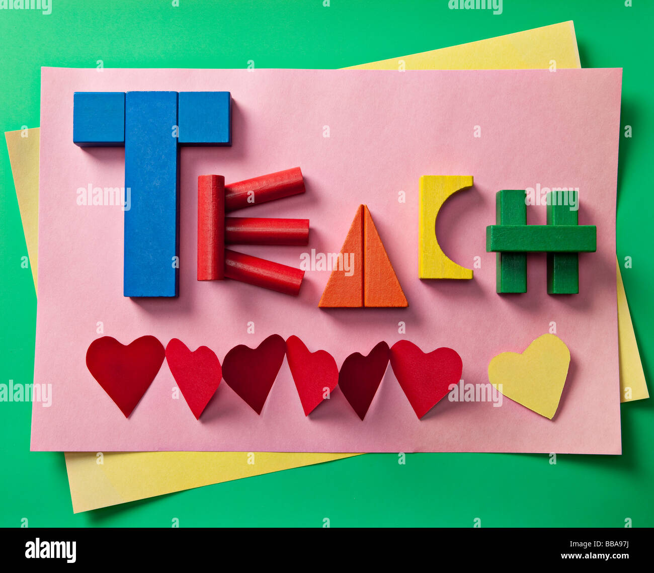 colorful blocks spelling the word teach - Stock Image