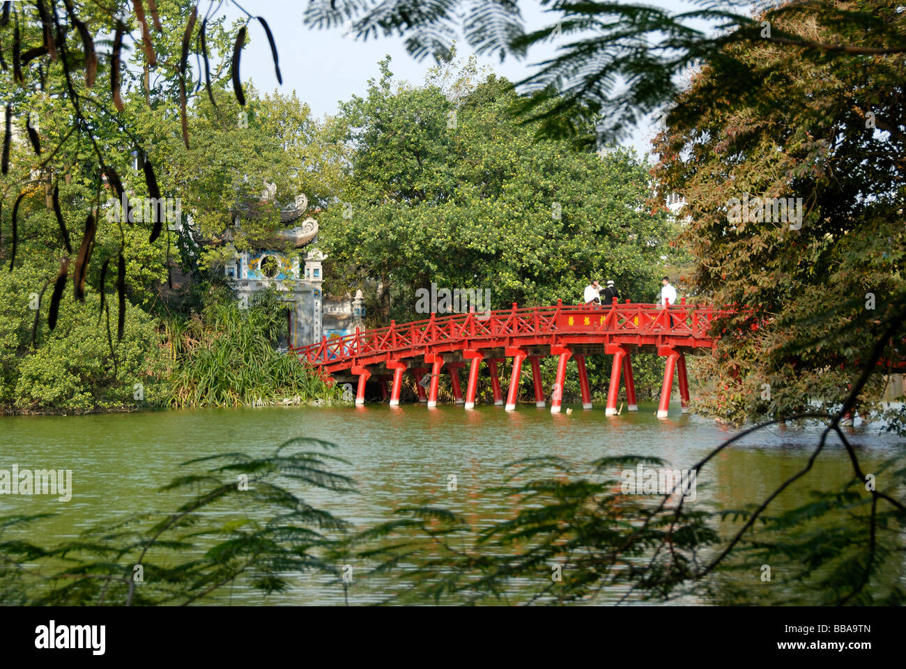 Buddhism, red wooden bridge with entrance tower to the Ngoc Son Temple, Hoan Kiem Lake, Hanoi, Vietnam, Southeast - Stock Image