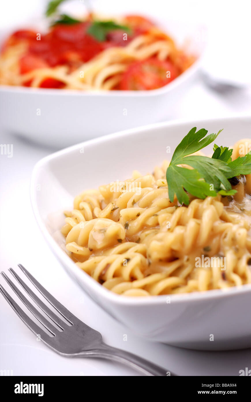 Two servings of delicious pasta - Stock Image