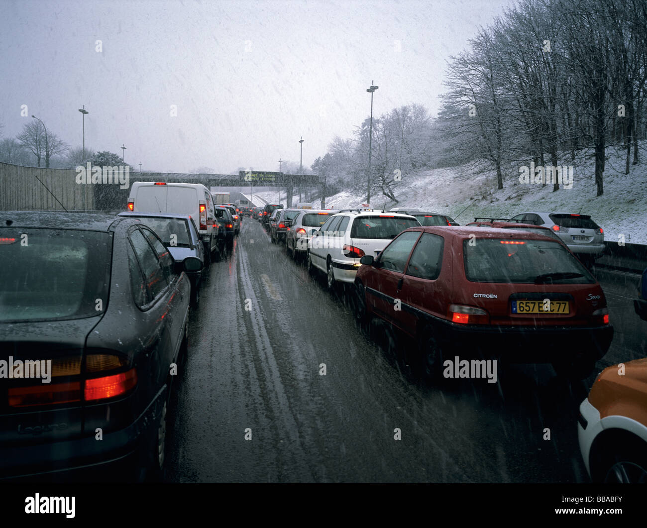 6x4.5cm Paris, France, A13 speedway traffic cork due to snow fall - Stock Image