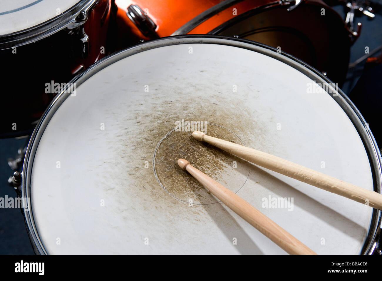 Detail of drumsticks on a drum kit - Stock Image
