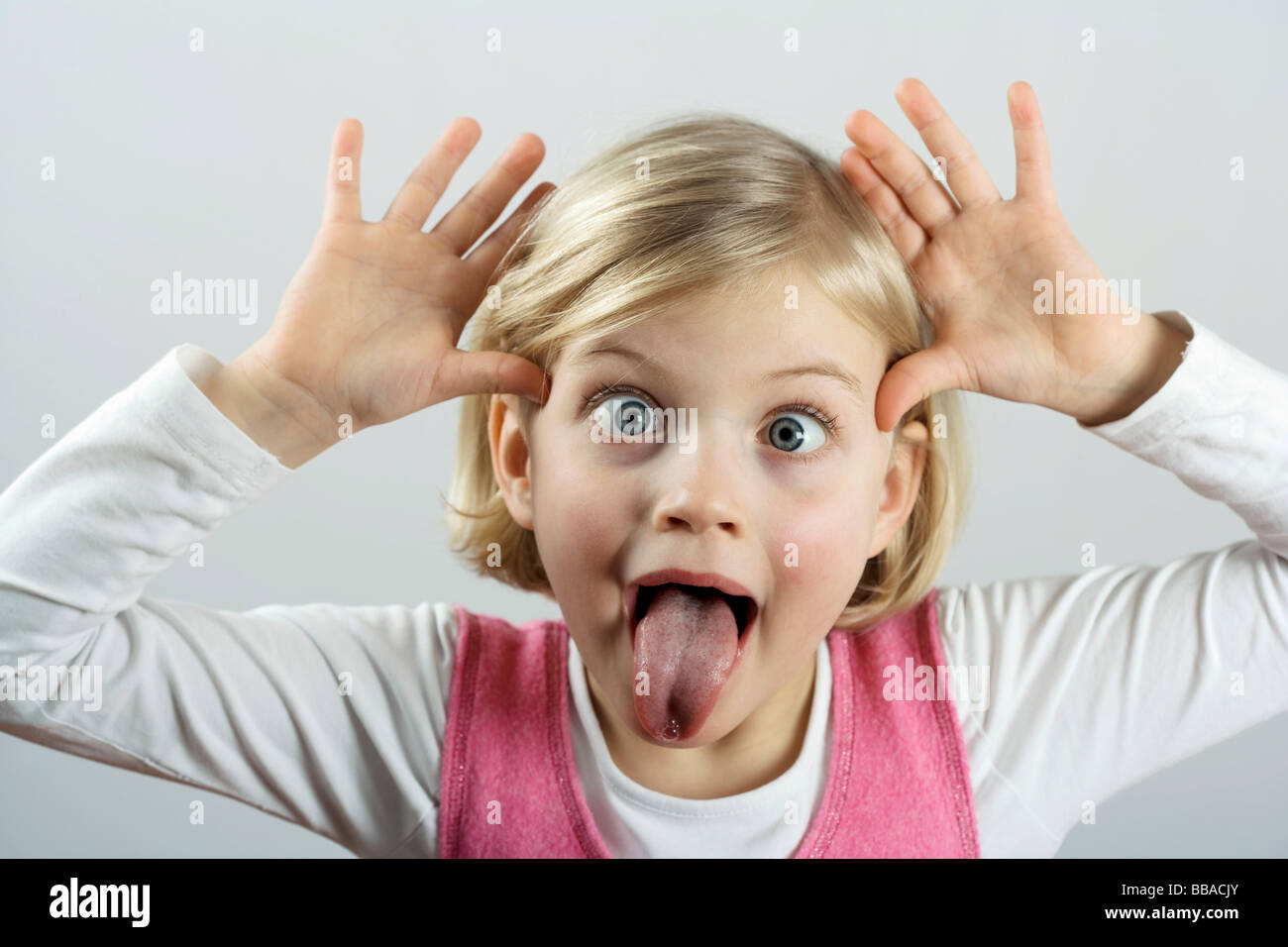 A little girl making a funny face - Stock Image