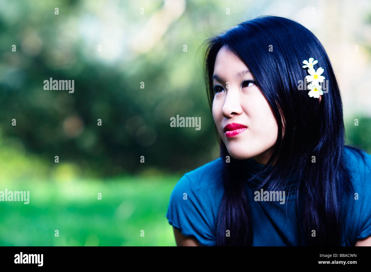 Young Asian girl in a park Stock Photo